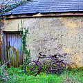 Old Irish Cottage With Bike By The Door by Bill Cannon
