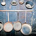 Old Kitchen Utensils On Soot-black Wall by Stephan Pietzko
