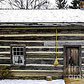 Old Log Home With A Broom by Les Palenik