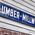 Old Lumberyard Sign by Olivier Le Queinec