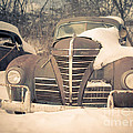 Old Plymouth Classic Car In The Snow by Edward Fielding