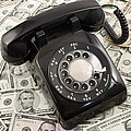 Old Rotary Phone On Money Background by Keith Webber Jr