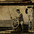 old sailor A vintage processed photo of a sailor sitted behind the rudder in Mediterranean sailing by Pedro Cardona Llambias