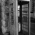 old style red telephone box with missing door in Carnlough county antrim by Joe Fox