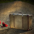 Old Suitcase With Red Shoes Left On Road by Sandra Cunningham