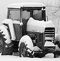 Old Tractor In The Snow by Jan M Holden