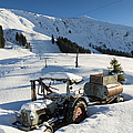 Old Tractor In Winter With Lots Of Snow Waiting For Spring by Matthias Hauser