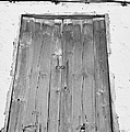 old weathered brown wooden door double window opening on abandoned house with cracked stucco yellow walls in Tacoronte Tenerife Canary Islands Spain by Joe Fox
