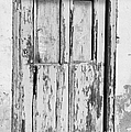 old weathered green painted wooden door entrance to abandoned house with cracked stucco walls in Tacoronte Tenerife Canary Islands Spain by Joe Fox