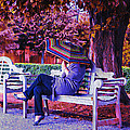 On A Bench Under An Umbrella In Autumn by Bill Cannon