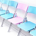 One Pink Chair In A Row Of Blue Chairs by Cordelia Molloy/science Photo Library