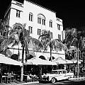 Orange Chevrolet Bel Air In The Cuban Style Outside The Edison Hotel by Joe Fox