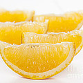 Orange Wedges On White Background by Colin and Linda McKie