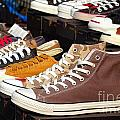 Outdoor Vendor Sells Canvas Shoes by Yali Shi