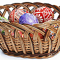 painted Easter Eggs in wicker basket by Michal Boubin