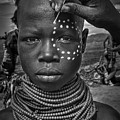 Painting The Face Of A Karo Tribe Girl (omo Valley-ethiopia) by Joxe Inazio Kuesta