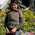 Pakistani Boy In Front Of Hotel Ruins In Swat Valley by Imran Ahmed