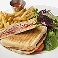 Panini With Ham Melted Cheese French Fries And Salad by Jit Lim