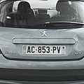 Paris Blue Peugeot by Evie Carrier