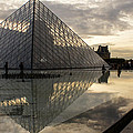 Paris - Louvre Pyramid Reflecting In The Fountain's Pool by Georgia Mizuleva