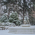 Park Fountain During Winter Snowfall At Sayen Gardens by Beth Sawickie