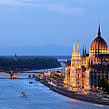 Parliament Building In Budapest At Evening by Artur Bogacki