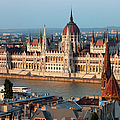 Parliament Building In Budapest At Sunset by Artur Bogacki