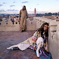 Paul Getty Jr And Talitha Getty On A Terrace by Patrick Lichfield