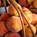 Peaches In Wicker Basket by Teri Virbickis