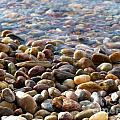 Pebbles On The Shore by Leone Lund
