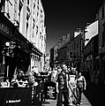 Pedestrians And Drinkers Enjoying A Sunday Afternoon Drink In The Bunch Of Grapes Pub Galway by Joe Fox