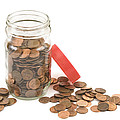 Pennies And Jar On White Background by Keith Webber Jr