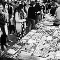 people buying chocolates on display inside the la boqueria market in Barcelona Catalonia Spain by Joe Fox