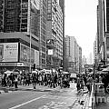 People Crossing The Street On A Rainy Day In Mong Kok Hong Kong by Ivy Ho