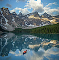 Person In Canoe On Moraine Lake, Banff by Paul Zizka