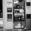petro canada winter gas fuel pump at service station Regina Saskatchewan Canada by Joe Fox