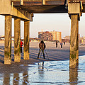 Photographer Under The Pier by Frank Winters