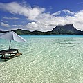 Picnic Table And Umbrella In Clear Lagoon by M Swiet Productions