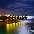 Pier At Night by Carlos Caetano