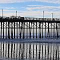 Pier Reflections  by Christy Pooschke