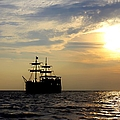 Pirate Ship At Sunset by Debra Forand