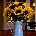 Pitcher Of Sunflowers by Eric Tressler