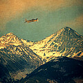 Plane Flying Over Mountains by Jill Battaglia