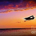 Plane Pass At Sunset by John Malone