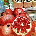 Pomegranates In Open Market by Lesa Fine
