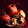 Pomegranates by Romulo Yanes