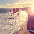 Port Campbell National Park Twelve Apostles With Sun Flare by Beverly Claire Kaiya