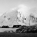 port lockroy british Antarctica trust base museum with anvers island in the background by Joe Fox