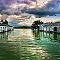 Storm Clouds Over  Port Royal Boathouses In Naples by Ginger Wakem