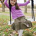 Portrait Of Young Girl On Swing by Vast Photography